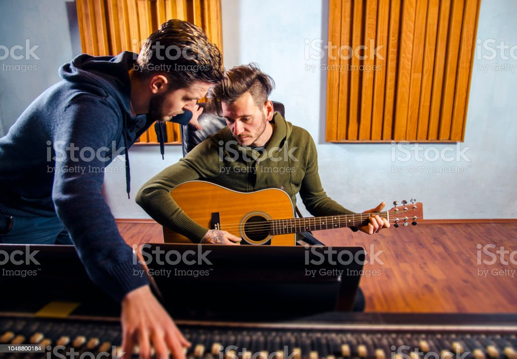 Producer and artist in studio consulting stock photo