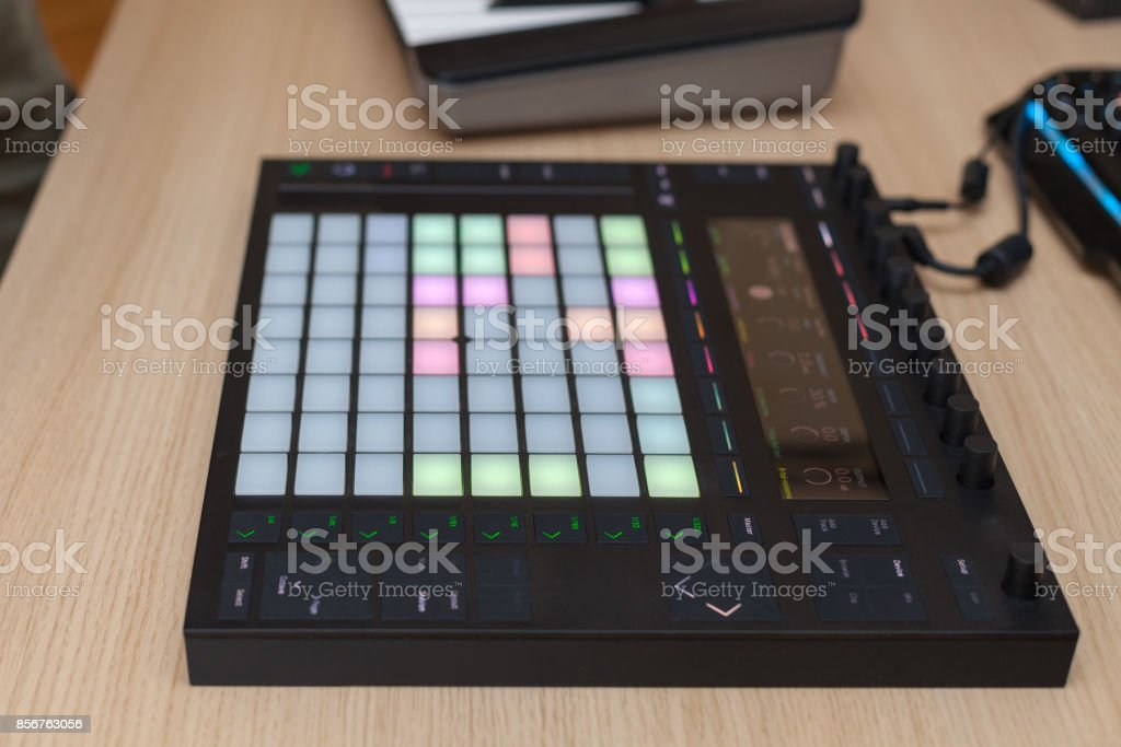 Producer makes a music on professional production controller with push button pads stock photo