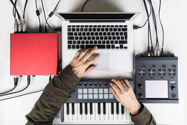 Producing and mixing modern style beats music, beat making and arranging audio content with software controllers and digital effects processors Recording electronic music track with portable midi keyboard on laptop computer in home studio electronic music stock pictures, royalty-free photos & images