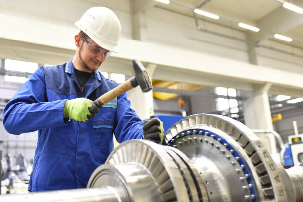 production and design of gas turbines in a modern industrial factory production and design of gas turbines in a modern industrial factory mechanical engineering stock pictures, royalty-free photos & images