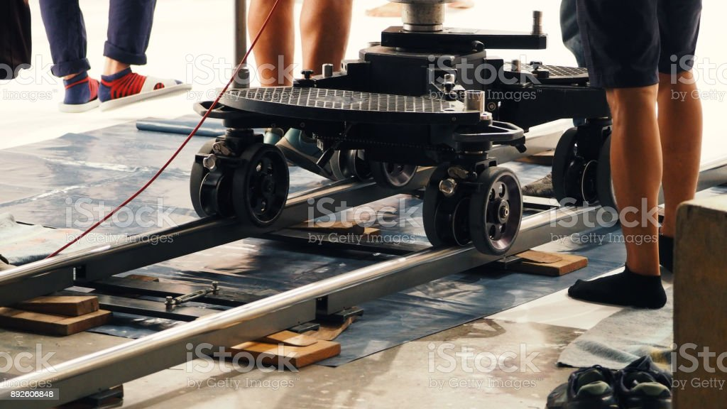 Production crew team setting dolly track stock photo