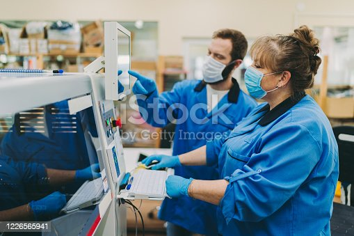 Quality control team working in production factory