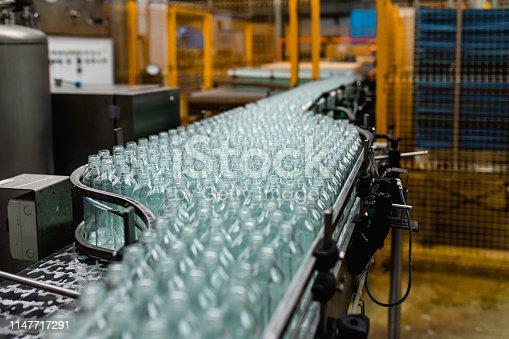 Bottling factory - Apple juice bottling line for processing and bottling juice into bottles. Selective focus.