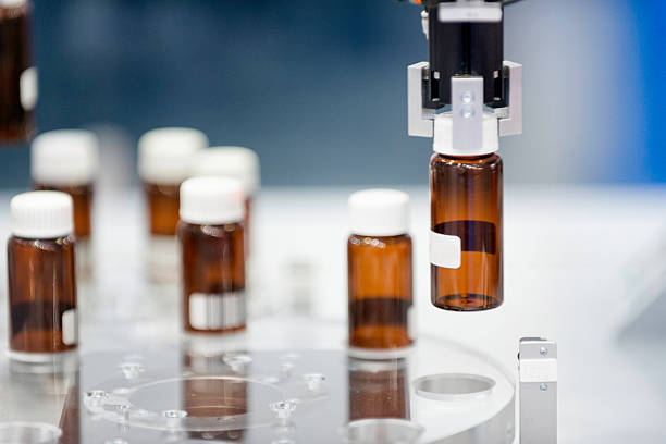 production line in pharmaceutical company - pharmaceutical factory stock pictures, royalty-free photos & images