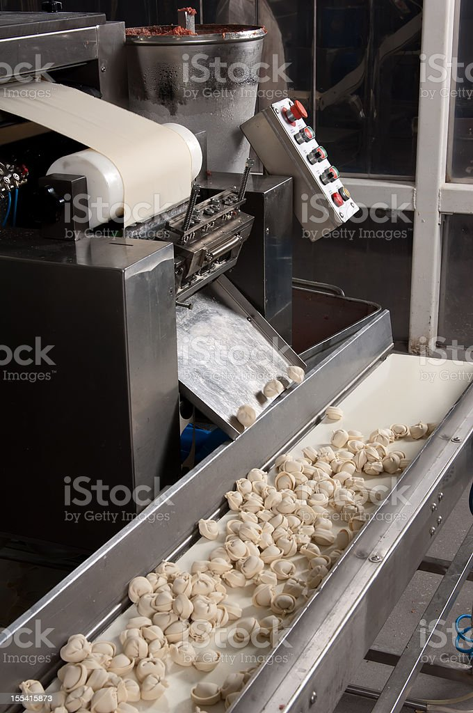 Production line machine in the food factory stock photo