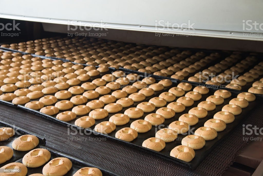 Production line of baking cookies on factory, food industry, closeup stock photo