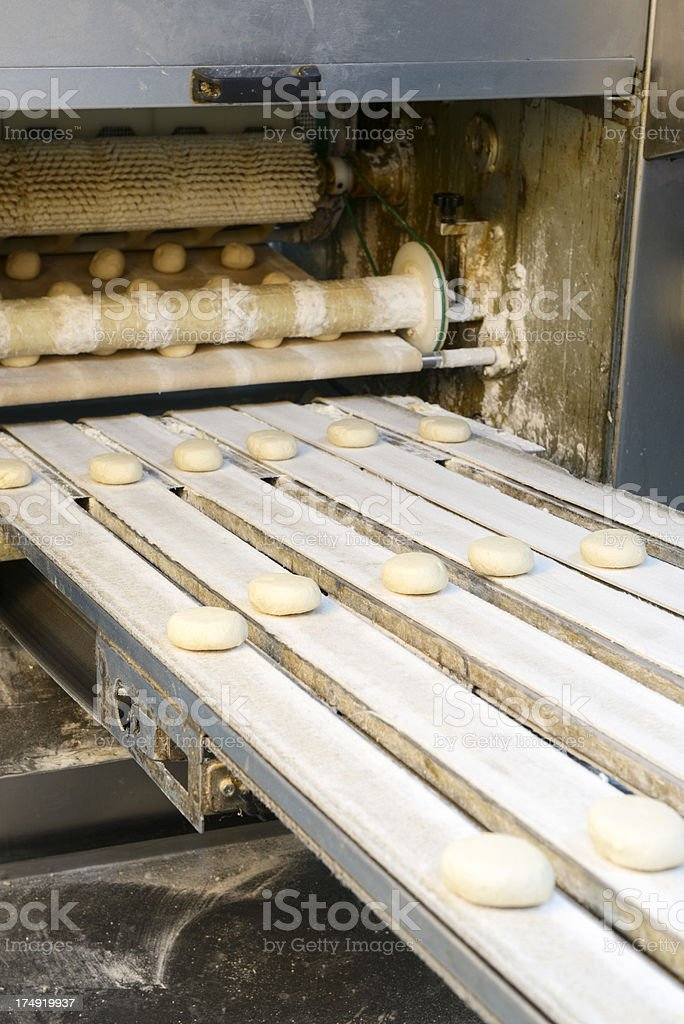 Production line of burger breads royalty-free stock photo