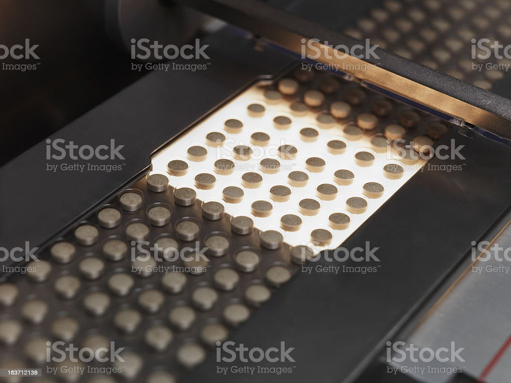 A production line of pill medication  royalty-free stock photo