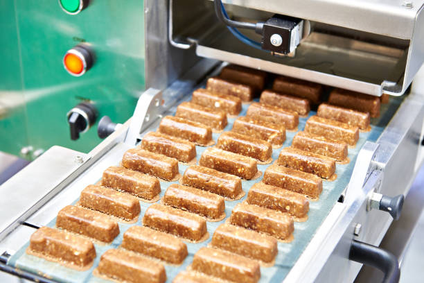 Production of confectionery on conveyor stock photo
