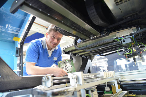 production of electronic components in a modern factory - engineer at the workplace stock photo