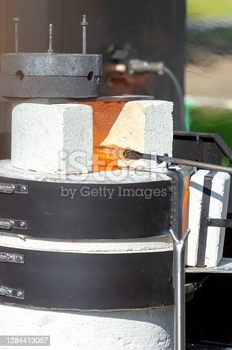 Production of glass in a special portable oven. Heat the glass mass at the end of the tube in a hot oven