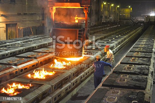 Berlin, Germany - May 11, 2012: Production of metal components in a foundry - group of workers