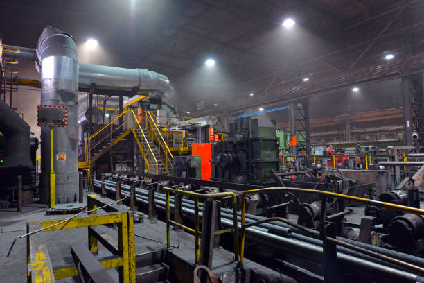 Production of metal tubes in a steel and rolling mill - architecture and technology in an industrial company stock photo