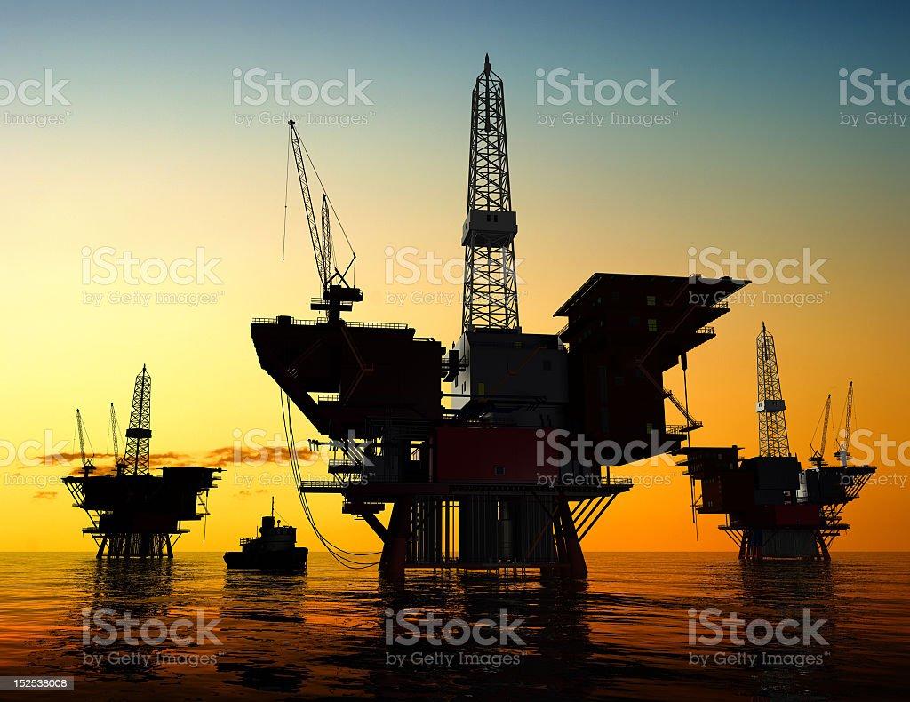 Production of petroleum at sunset stock photo