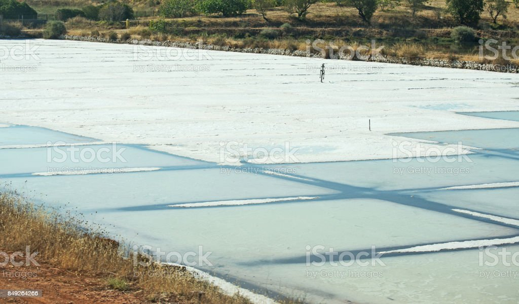 Production of sea salt in the Algarve region, Portugal. stock photo