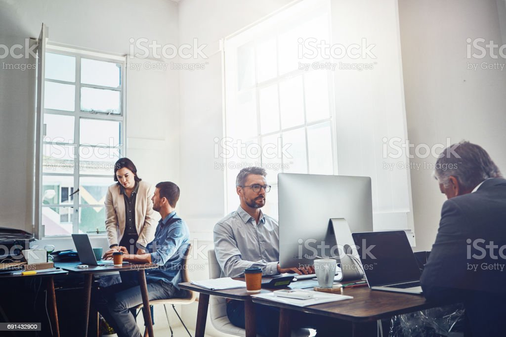Productive teams showing why they're the best stock photo