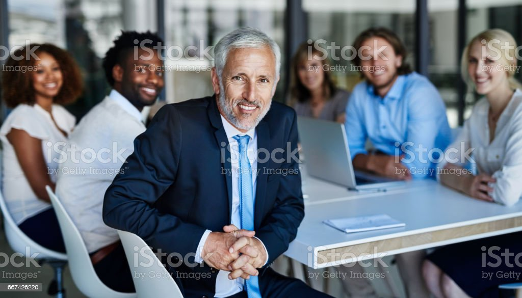 Productivity facilitated by the expert himself stock photo