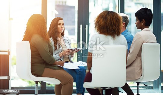 Shot of a team of colleagues having a meeting in a modern office