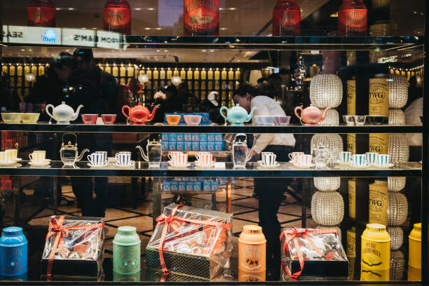 Products at the window of TWG tea shop in Leicester Square, London, UK. London, UK - November 21, 2018: Products at the window of TWG tea shop in Leicester Square. Leicester Square is a famous tourist area in London with lots of shops. tea room stock pictures, royalty-free photos & images