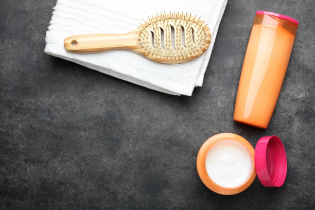 products for hair, bamboo comb and terry towel stock photo