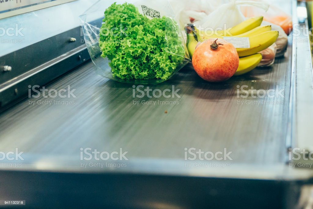 products on the cash desk. grocery shopping stock photo