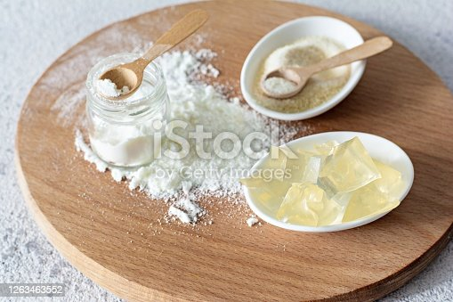 istock Products (collagen powder, gelatin) which contain collagen.Diced gelatin.Collagen powder on a light background. Extra protein intake. Natural beauty and health supplement for skin, bones, joints 1263463552
