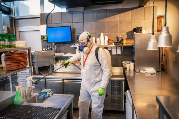 Profesional disinfector  , sprays disinfectants stock photo