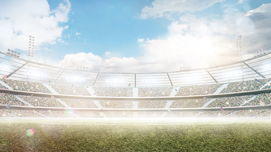 Profesional soccer stadium. Big sport arena. Daytime stadium under the sun with lights, fans and flags.