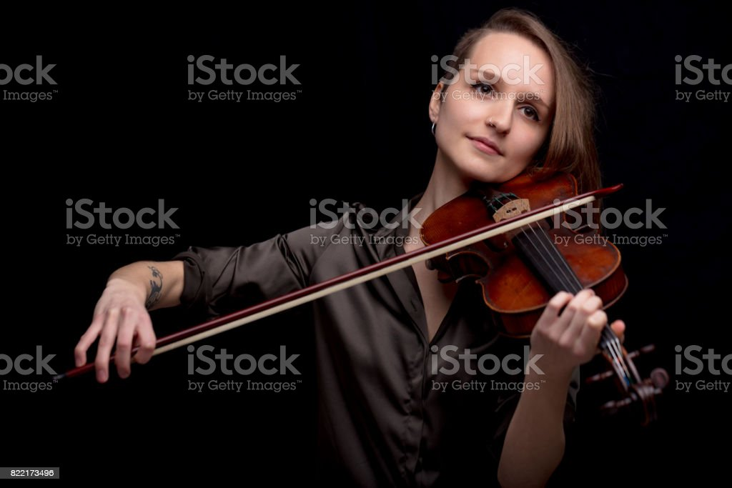 profesional violinist on a black background stock photo