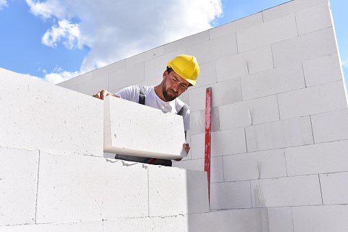 profession construction worker - work on a building site construction of a residential house