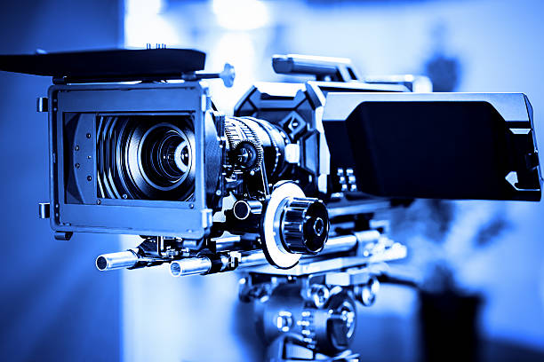 Professional 4k production video camera in studio Professional 4k production video camera in studio. Shallow DOF, selective focus. Toned image. ultra high definition television stock pictures, royalty-free photos & images