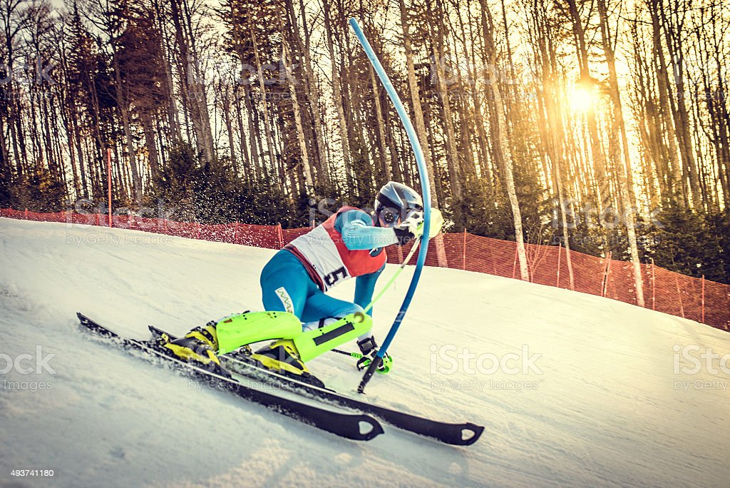 Professional Alpine Skier Taking sharp carving turn stock photo