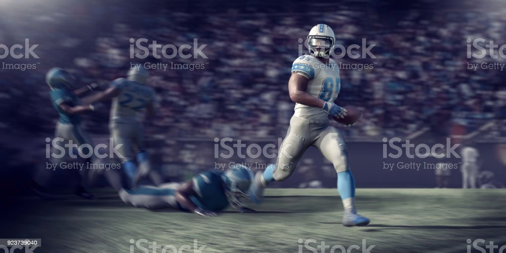 Professional American Football Player Running With Ball During Football Game stock photo