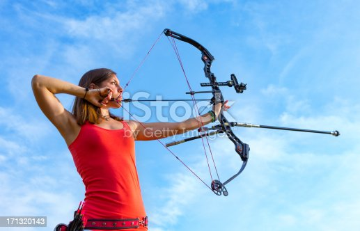 istock Professional archer aiming in position 171320143