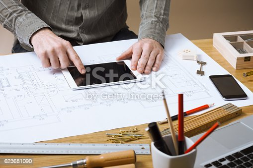 istock Professional architect working at his desk 623681090