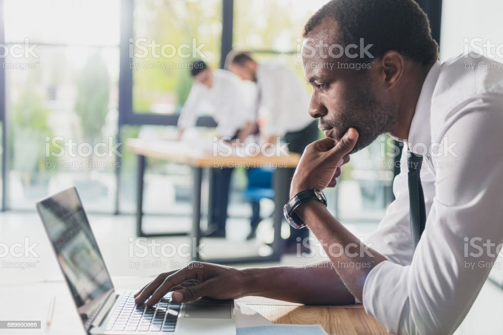 professional architects in formal wear working with laptop at modern office, businessmen group royalty-free stock photo