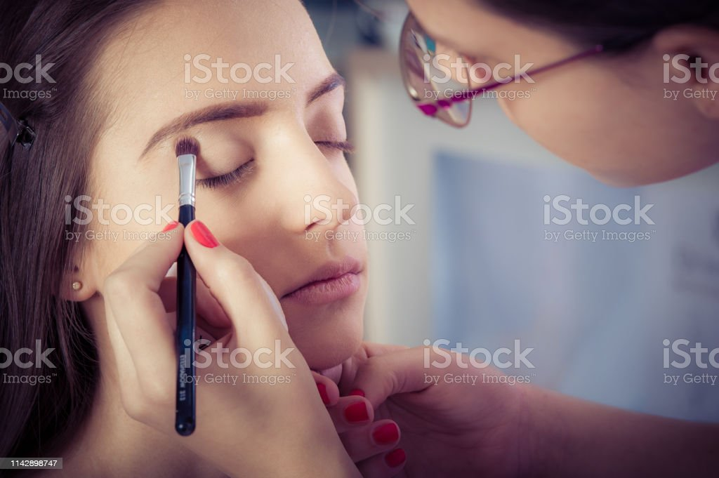 Professional Artist Is Making Beauty Makeup To Young Girl