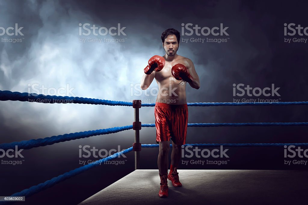Professional asian boxer guy with glove was practicing stock photo