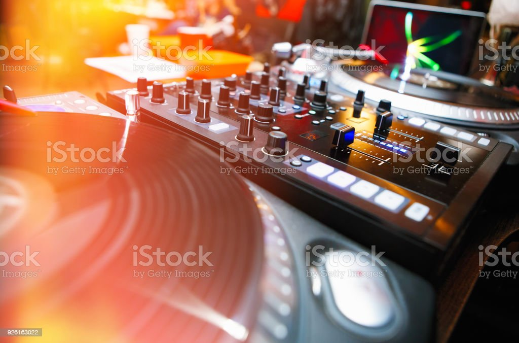 Professional audio equipment for club dj in bright stage lights stock photo