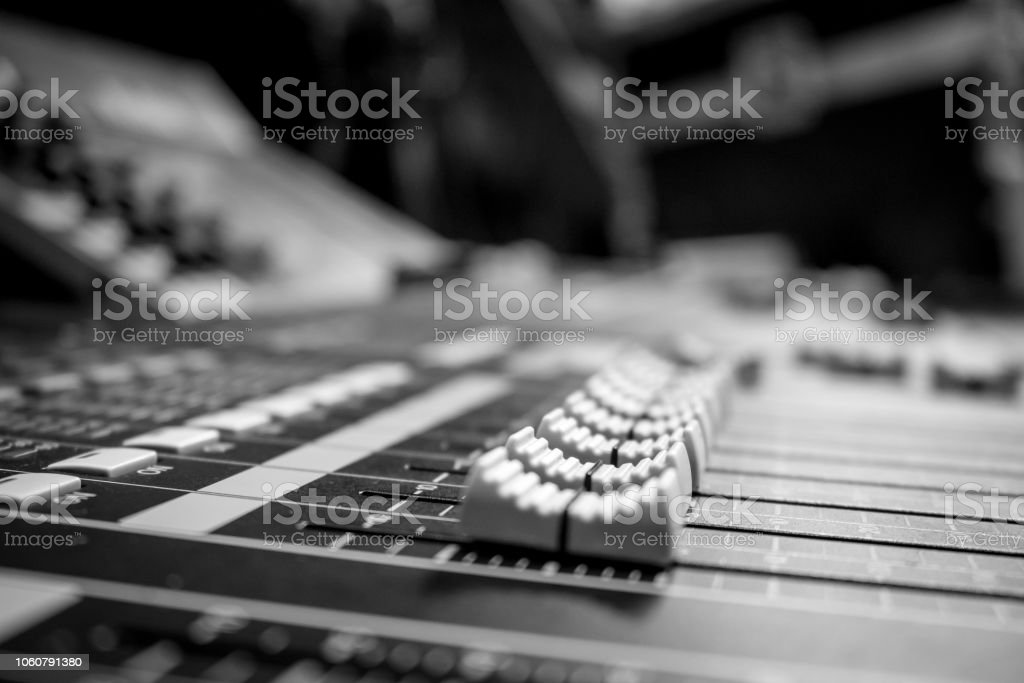 Low level view of a professional audio mixing console with rack...