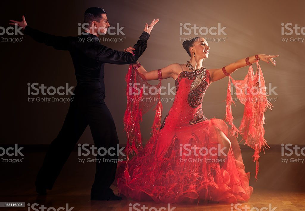 Professional ballroom dance couple preform an exhibition dance stock photo