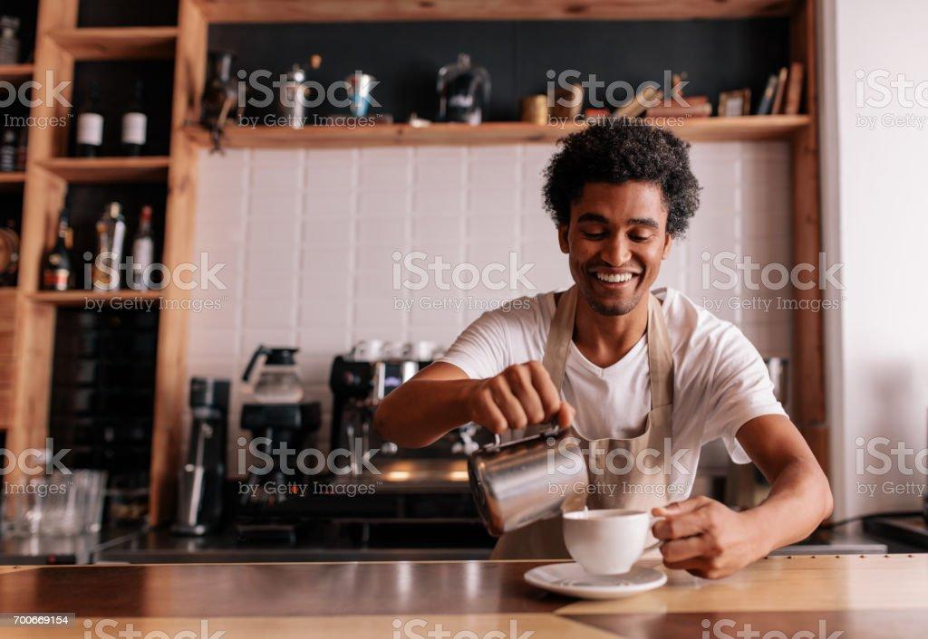 Professional barista making coffee stock photo