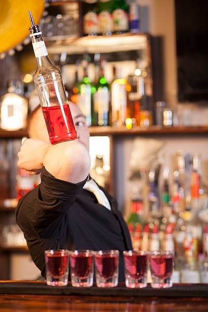Professional barmen making cocktail stock photo