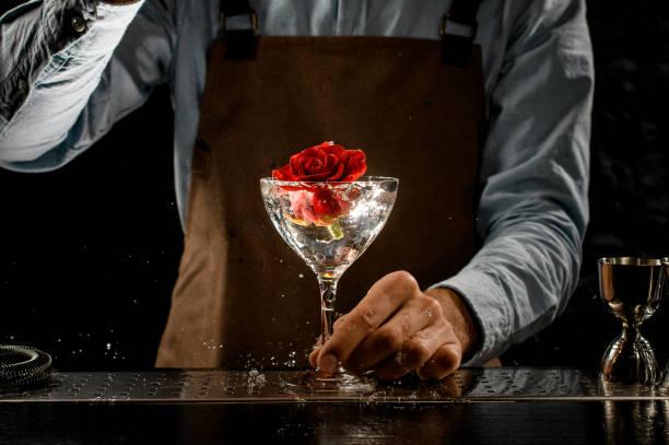 Professional bartender throwing a big red rose bud to a martini glass picture id1206099187?b=1&k=6&m=1206099187&s=612x612&w=0&h=mgrso0ye8kszr2knloboauaacc4xsqoolbtwjqssvew=