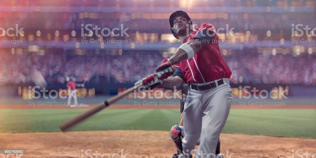 Professional Baseball Batter Hitting Ball During Night Game In Stadium stock photo