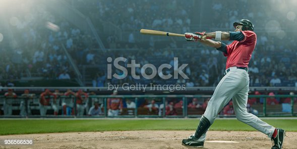 istock Professional Baseball Player Hits Ball In Mid Swing During Game 936566536