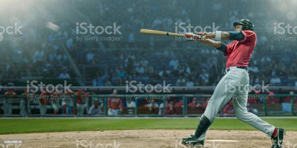 Professional Baseball Player Hits Ball In Mid Swing During Game – zdjęcie