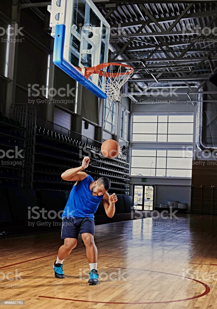 Black professional basketball player in action on a basketball field.