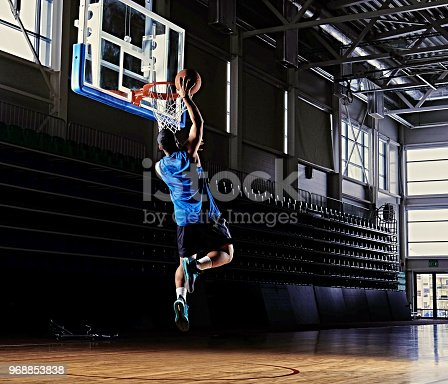 istock Professional basketball player in action on a basketball field. 968853838