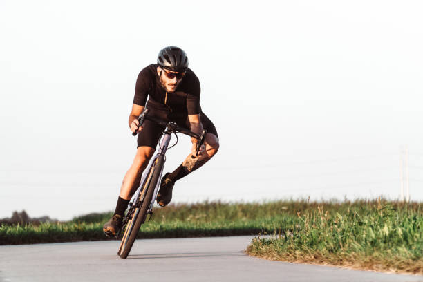 professional biker on the road stock photo